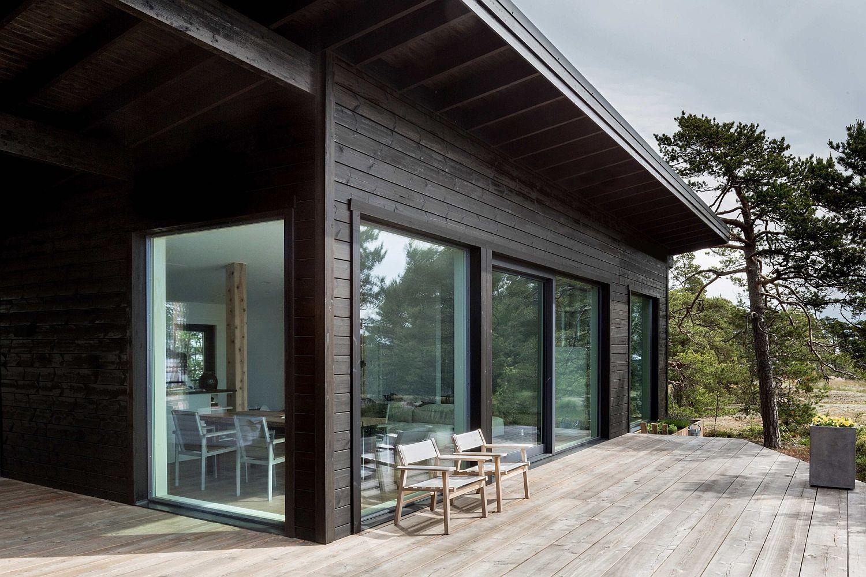 Modern Scandinavian Log Cabin Set On A Beautiful Baltic