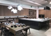 Modern-and-glossy-corner-kitchen-island-with-dining-area-GamaDecor-217x155
