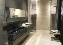 Modern-bathrom-tiles-in-beige-with-contrasting-darker-wall-tiles-by-Porcelanosa-217x155