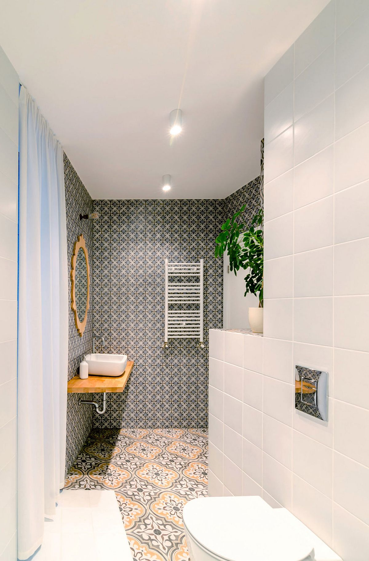 Modern bathroom in white with floor and walls covered in tiles
