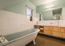 Modern-bathroom-in-white-with-standalone-tub-and-wooden-vanity-217x155