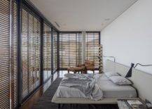 Modern-bedroom-in-white-with-glass-walls-and-wooden-slats-217x155