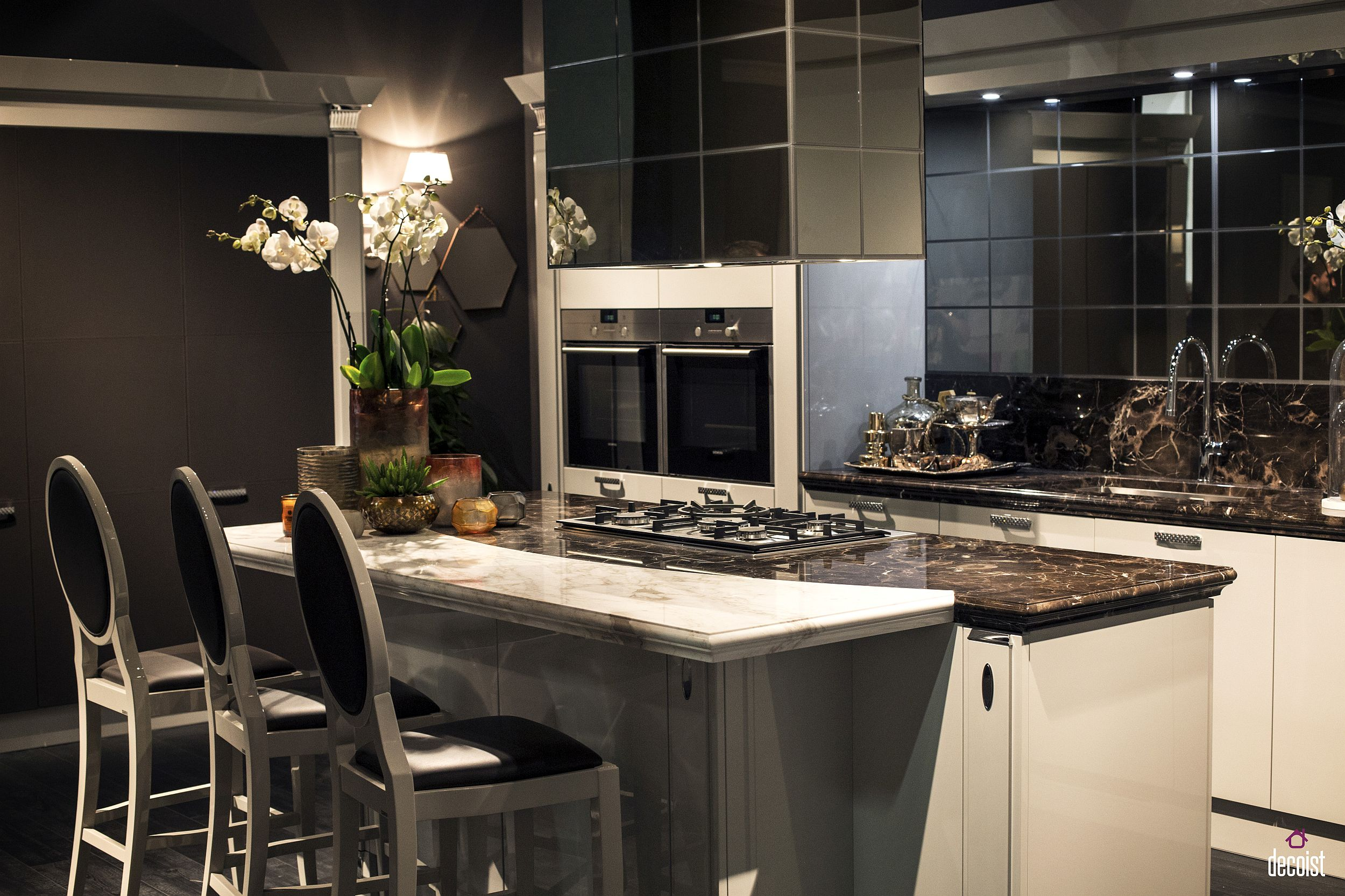 Modern classic kitchen from Scavolini in black and white with an island that multi tasks