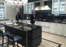 Modern-classic-kitchen-with-dark-island-and-a-stylish-backdrop-217x155