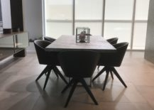 Modern-dining-area-with-marble-inspired-table-and-large-floor-tiles-by-Porcelanosa-217x155