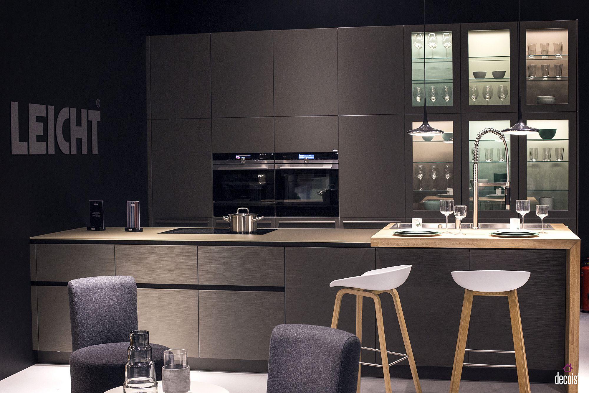 Modern kitchen in gray with wooden breakfast bar from Leicht