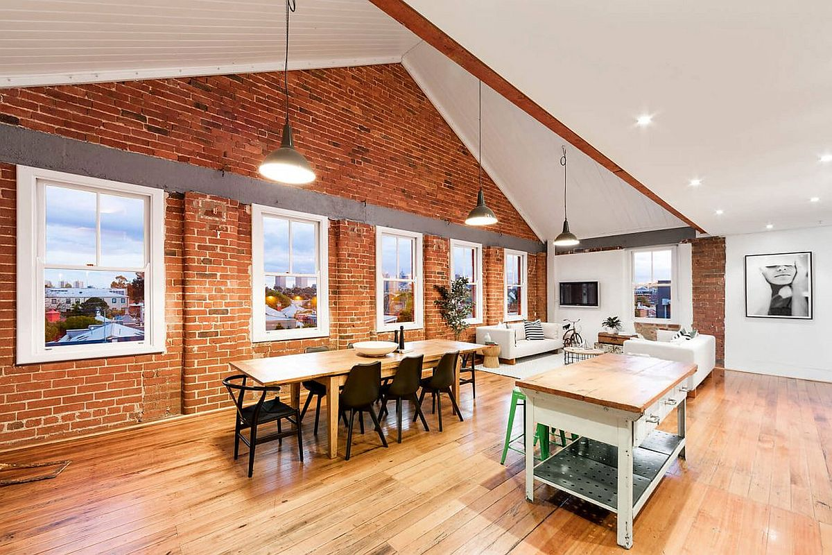 Old brick along with beam-and-truss ceiling give the apartment industrial charm