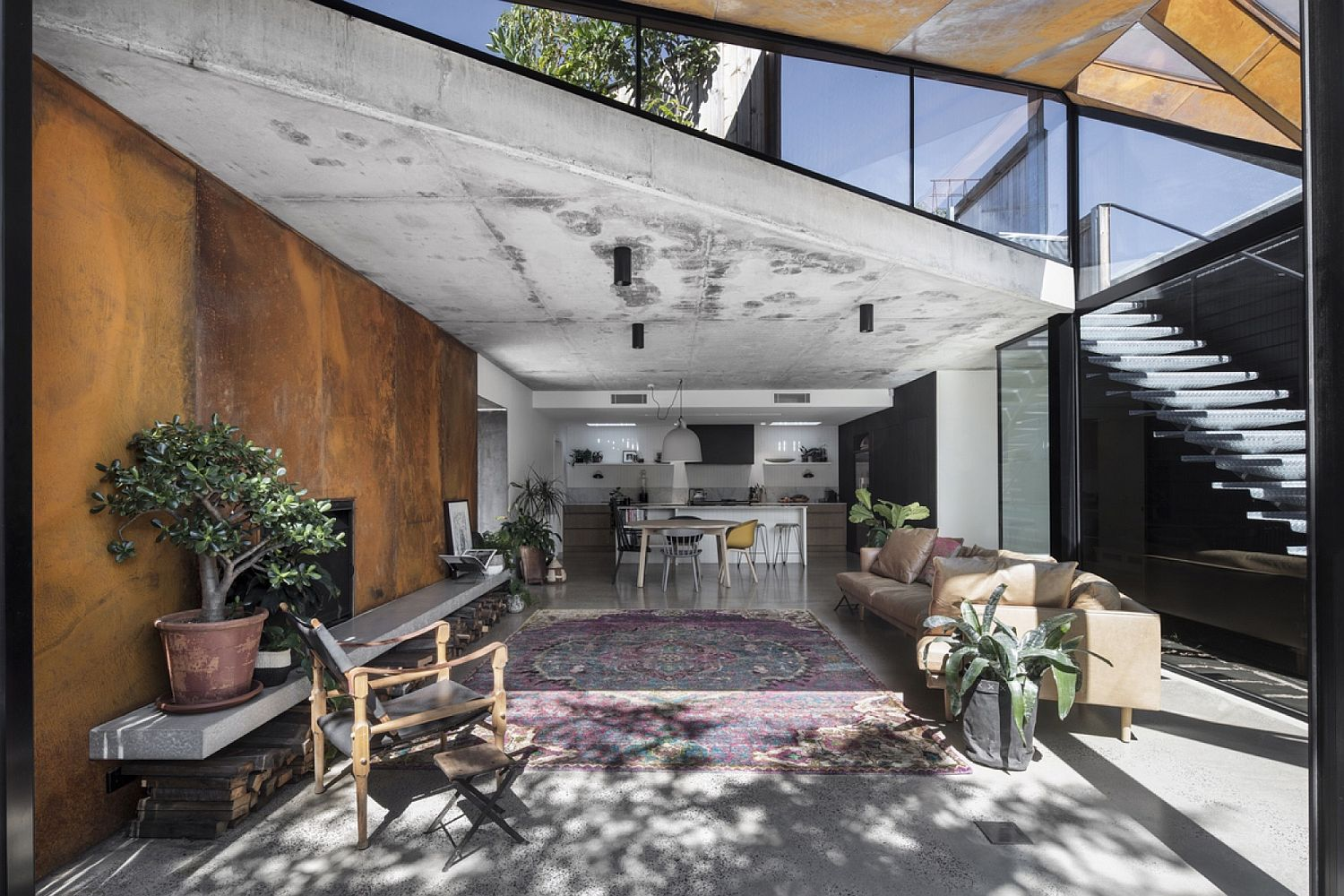 Open living with glass and green roof is a showstopper