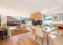 Open plan living with kitchen and dining on the lower level of the Sydney home 217x155 Single Level 60's Sydney Home Gets a Beachy Modern Upgrade