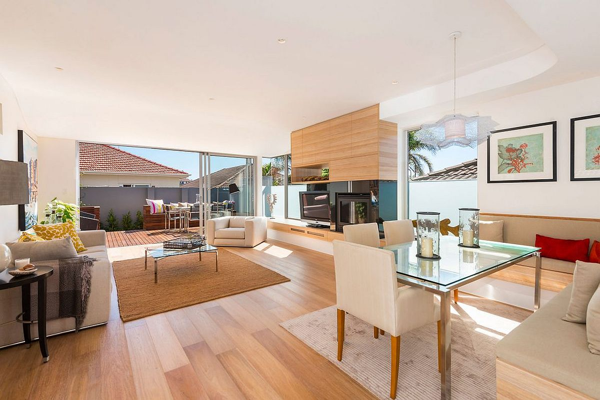 Open plan living with kitchen and dining on the lower level of the Sydney home