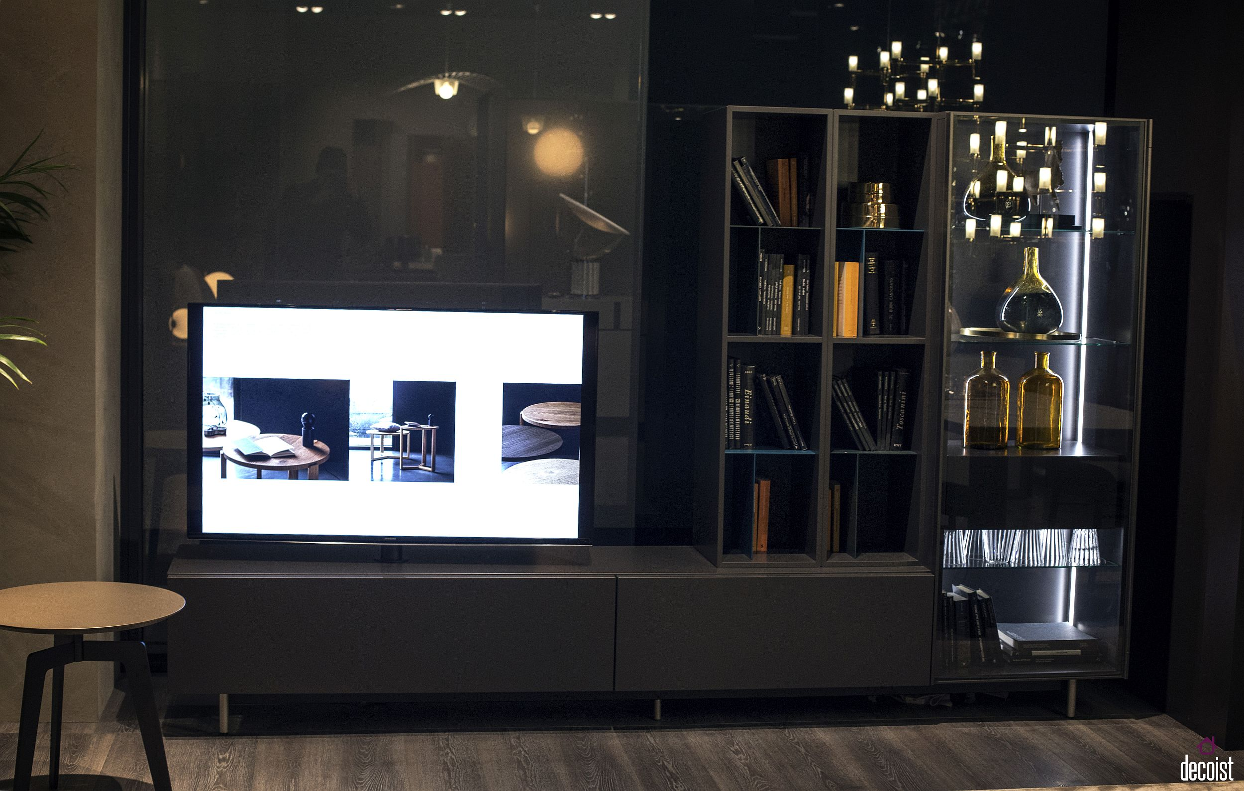 Open shelves with glass doors and LED lighting coupled with the gorgeous TV stand