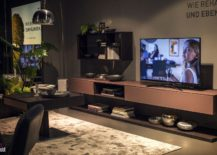 Open-wall-mounted-shelves-provide-additional-storage-space-next-to-the-TV-unit-217x155