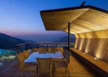 Open-wooden-deck-along-with-a-shaded-sitting-area-with-stunninv-views-of-the-valley-217x155