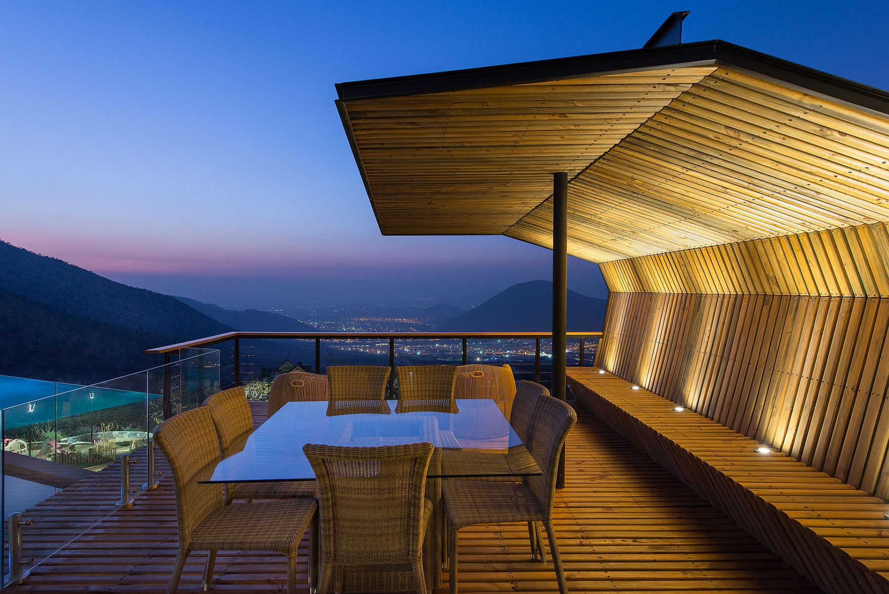 Open wooden deck along with a shaded sitting area with stunninv views of the valley
