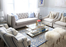 Place-a-glass-table-right-in-the-middle-of-heavily-furnished-living-room-217x155