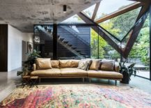 Plush-couch-and-colorful-rug-for-the-glassy-lounge-217x155