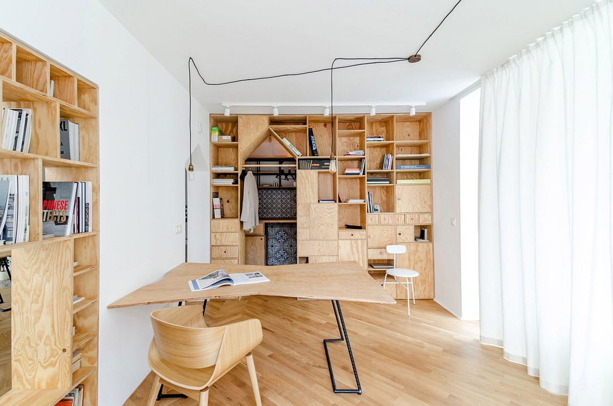ingenious plywood partitions and drapes turn apartment into workspace