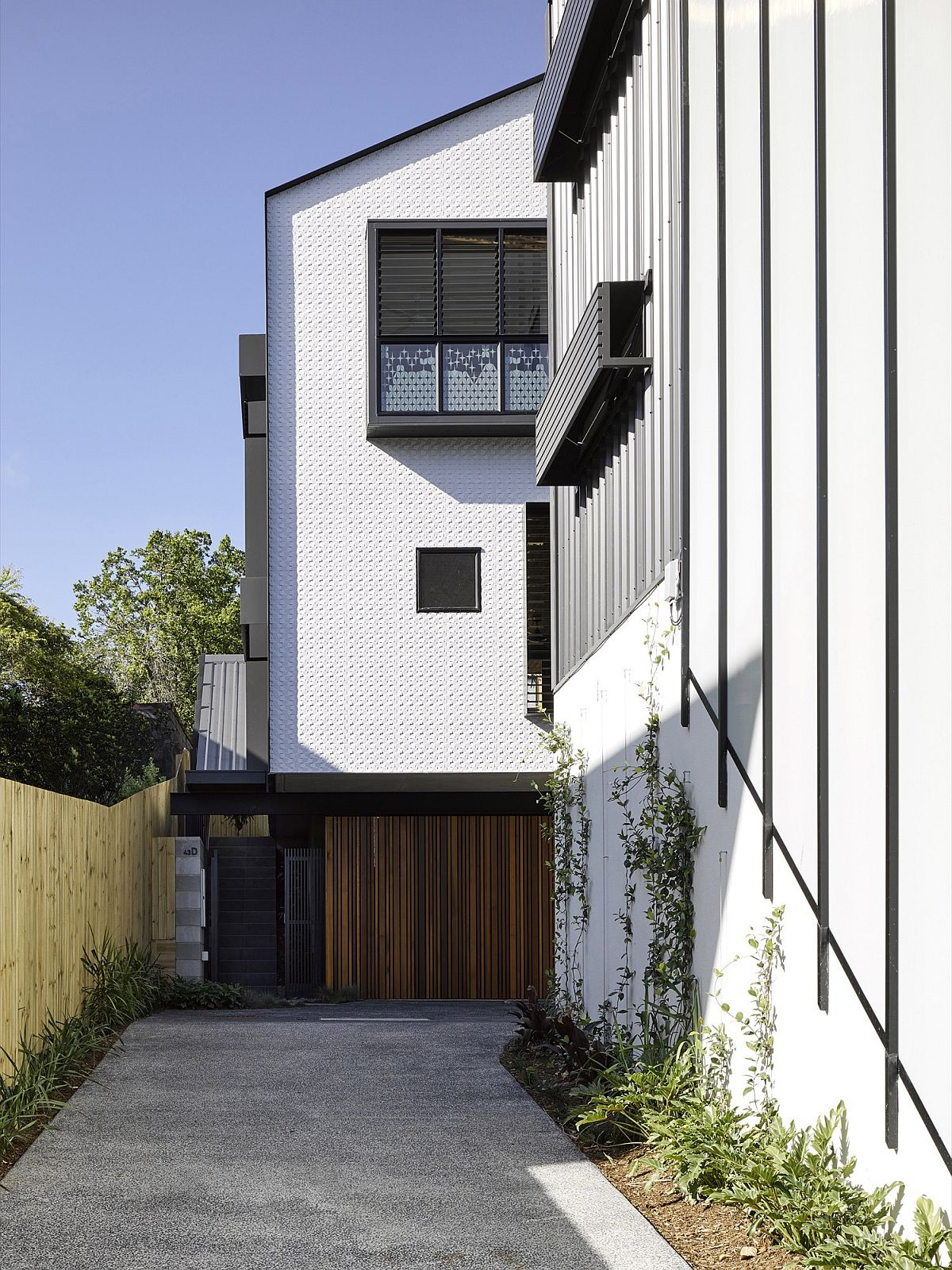 Private entryway leads to the remodeled series of Twonhouses in Brisbane