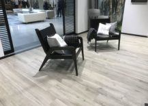 Relaxing-black-chairs-over-contrasting-wood-inspired-floor-tiles-by-Porcelanosa-217x155