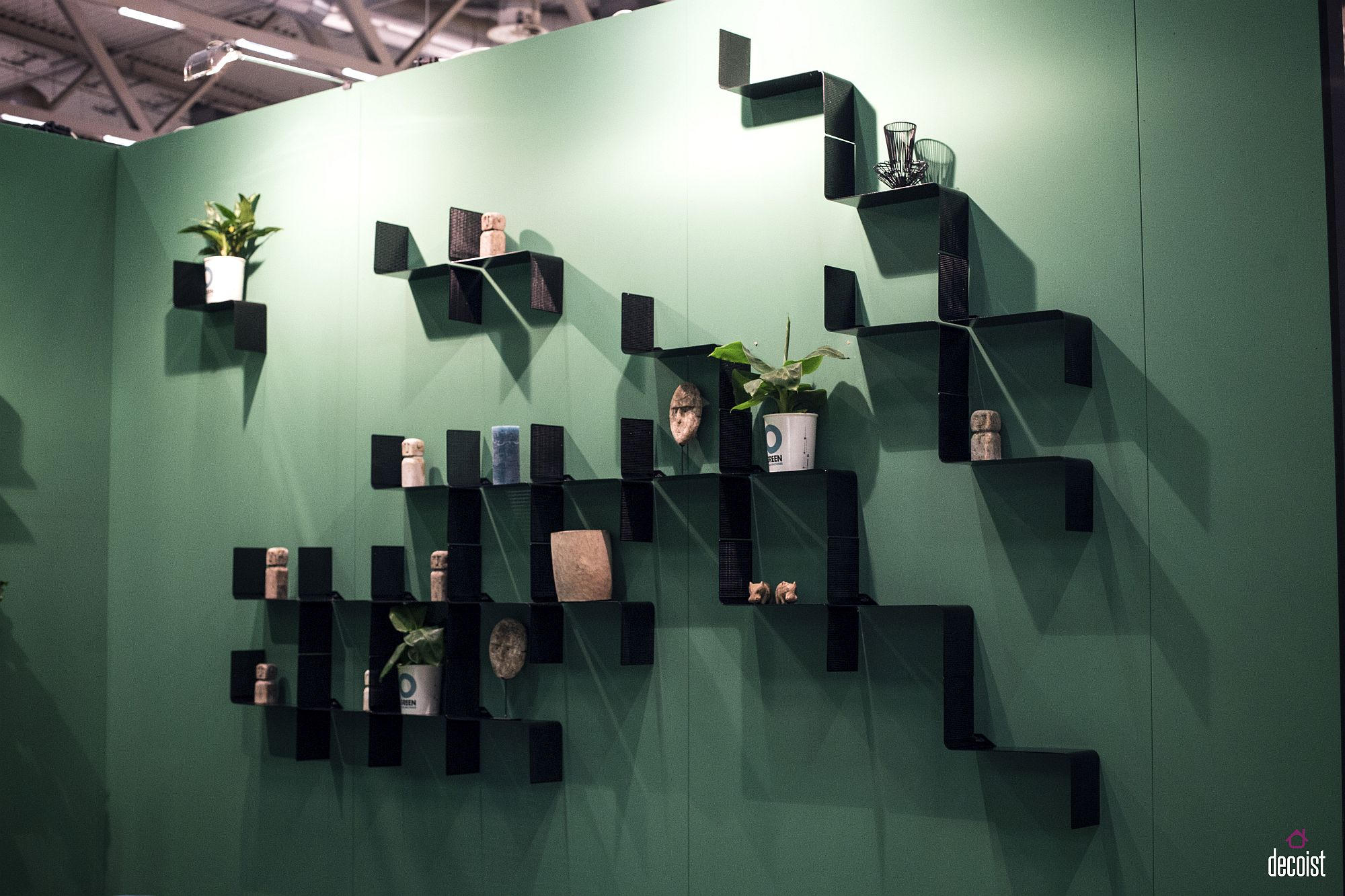 Repeating these snazzy shelves creates a great accent wall that also offers display space