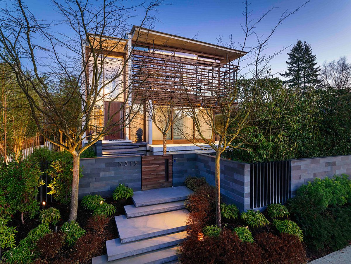 Sapele wood slats and a wall of greenery create a beautiful street facade at the Vancouver Residence Oriental Inspiration Finds Space Inside this Lavish Vancouver Residence!