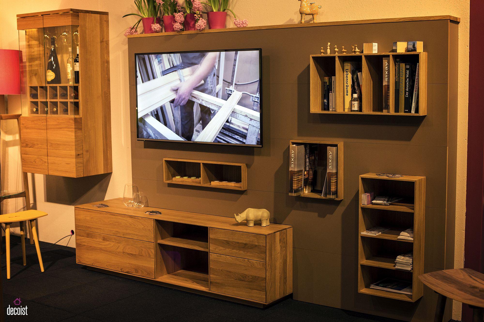 Series of open shelves in the living room combine ergonomics with aesthetics