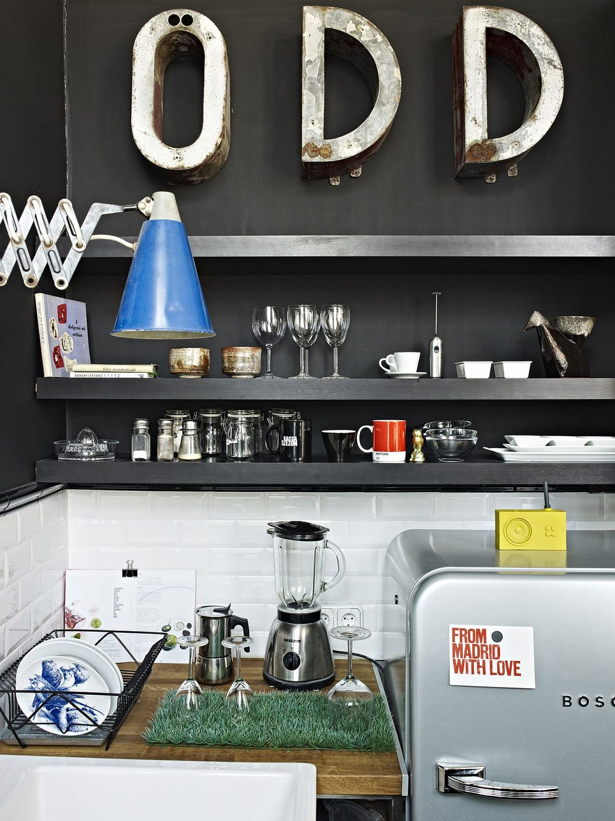 Sleek contemporary shelves in the black for the dark kitchenette