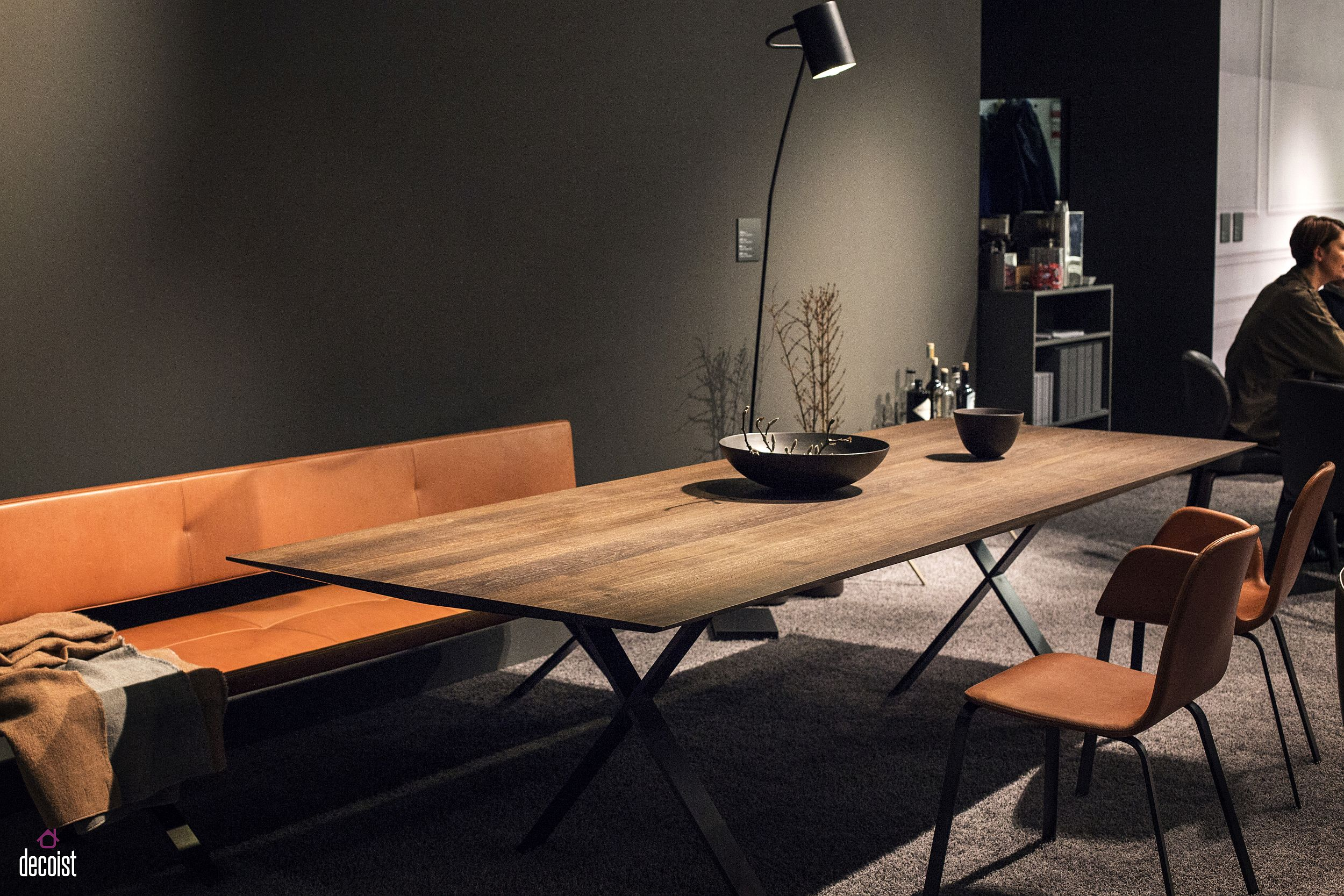 Sleek, dining table, modern cushioned bench and leather chairs for the chic dining room
