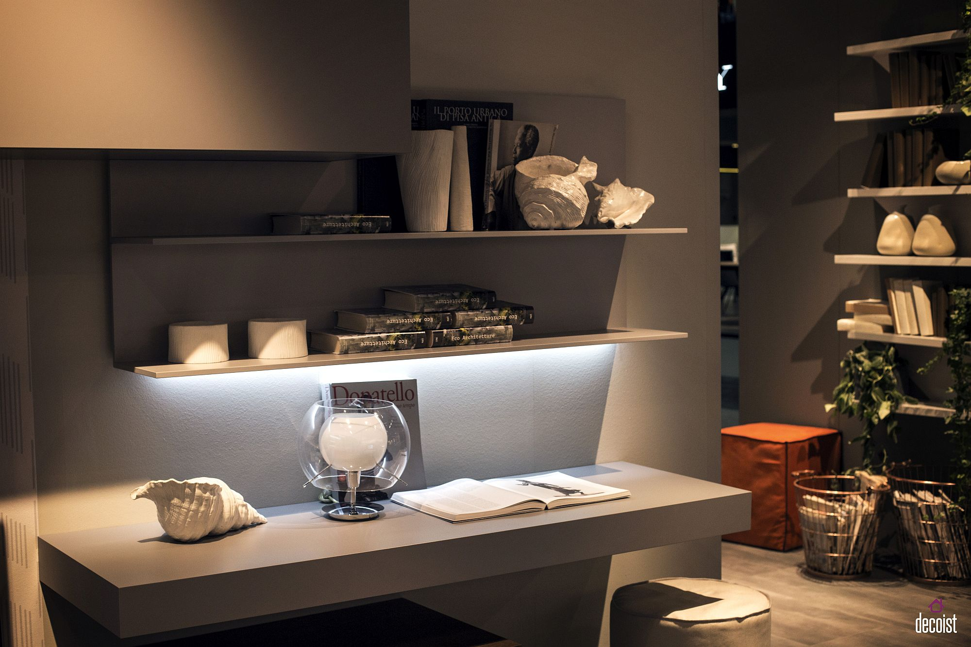 Slim floating shelves above the home office workdesk save space