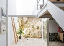 Small-atrium-brings-light-into-the-lower-level-of-the-Spanish-house-217x155