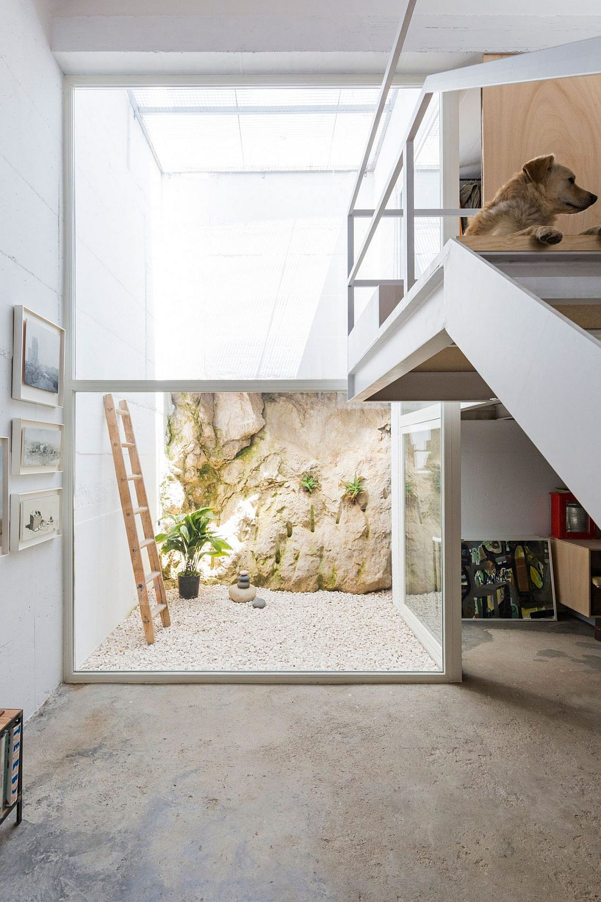 Small atrium brings light into the lower level of the Spanish house