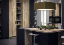 Small-kitchen-island-with-wooden-and-polished-countertop-sections-and-a-uber-small-breakfast-bar-217x155