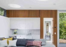 Smart-interior-of-the-guestouse-with-gray-sectional-and-white-backdrop-217x155