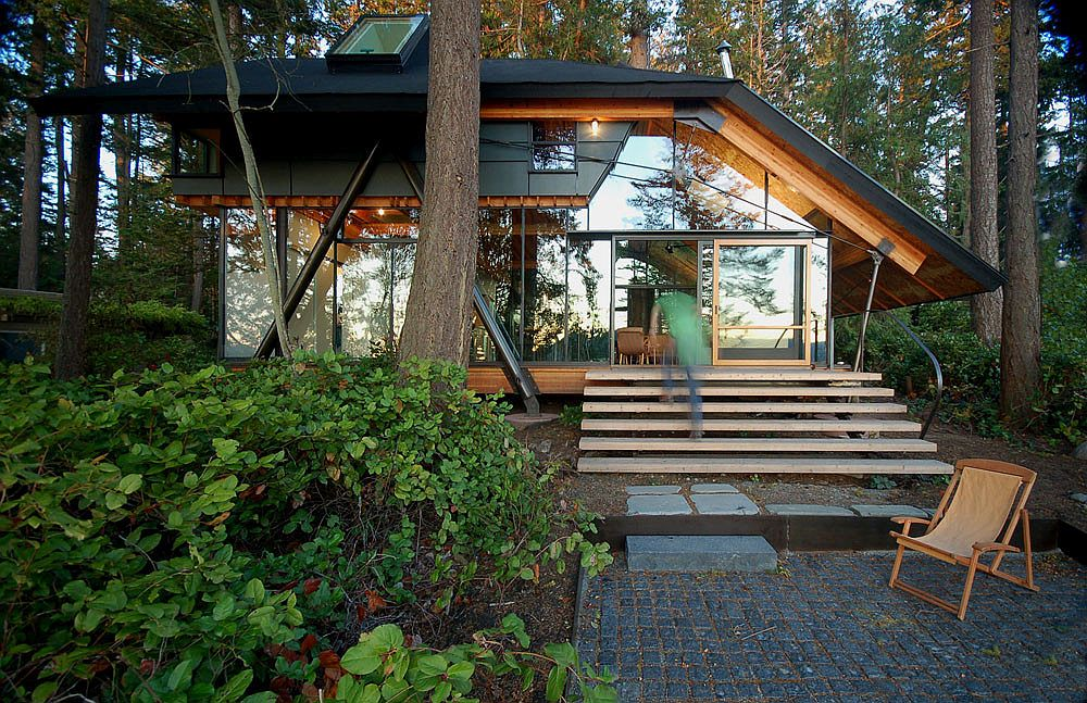 Sneeoosh Cabin set in a lush green landscape surrounded by fir and cedar trees Caring for the Planet: Tranquil Cabin Retreat in Washington