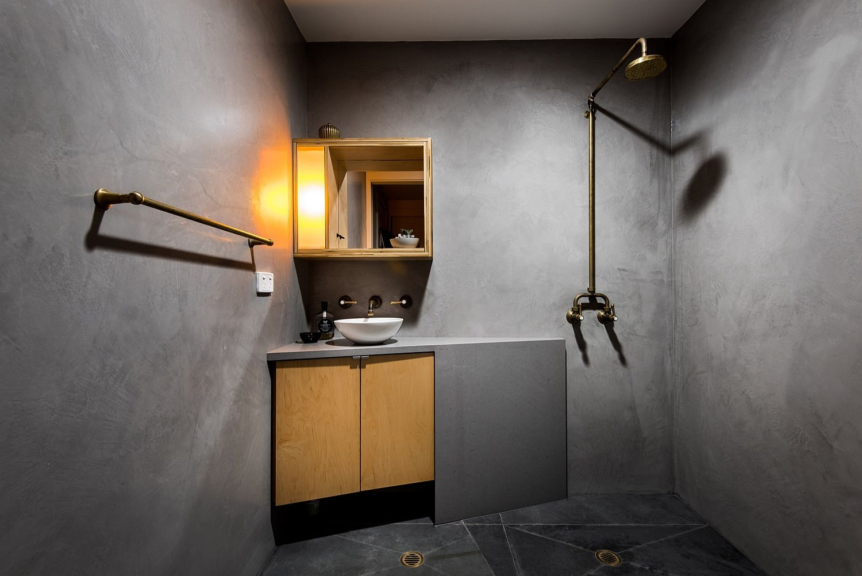 Space-savvy and minimal bathroom with corner sink, vanity and medicine cabinet