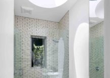 Spacious-bathroom-in-white-with-skylight-217x155