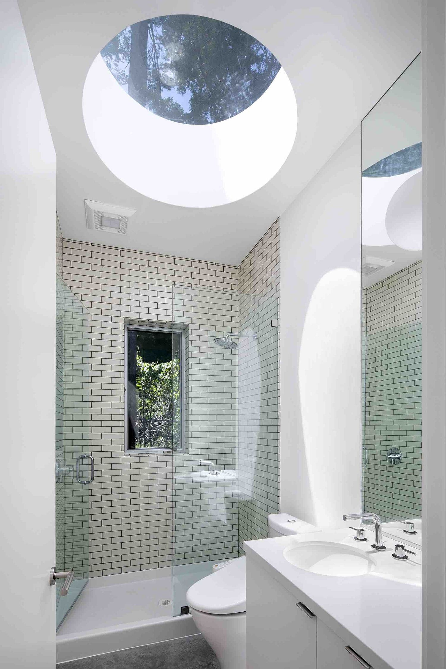 Spacious bathroom in white with skylight