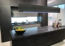 State-of-the-art-kitchen-with-stone-inspired-island-GamaDecor-217x155