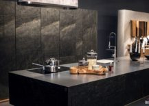 Stone-kitchen-island-cabinets-in-matching-finish-give-the-interior-an-exotic-look-217x155
