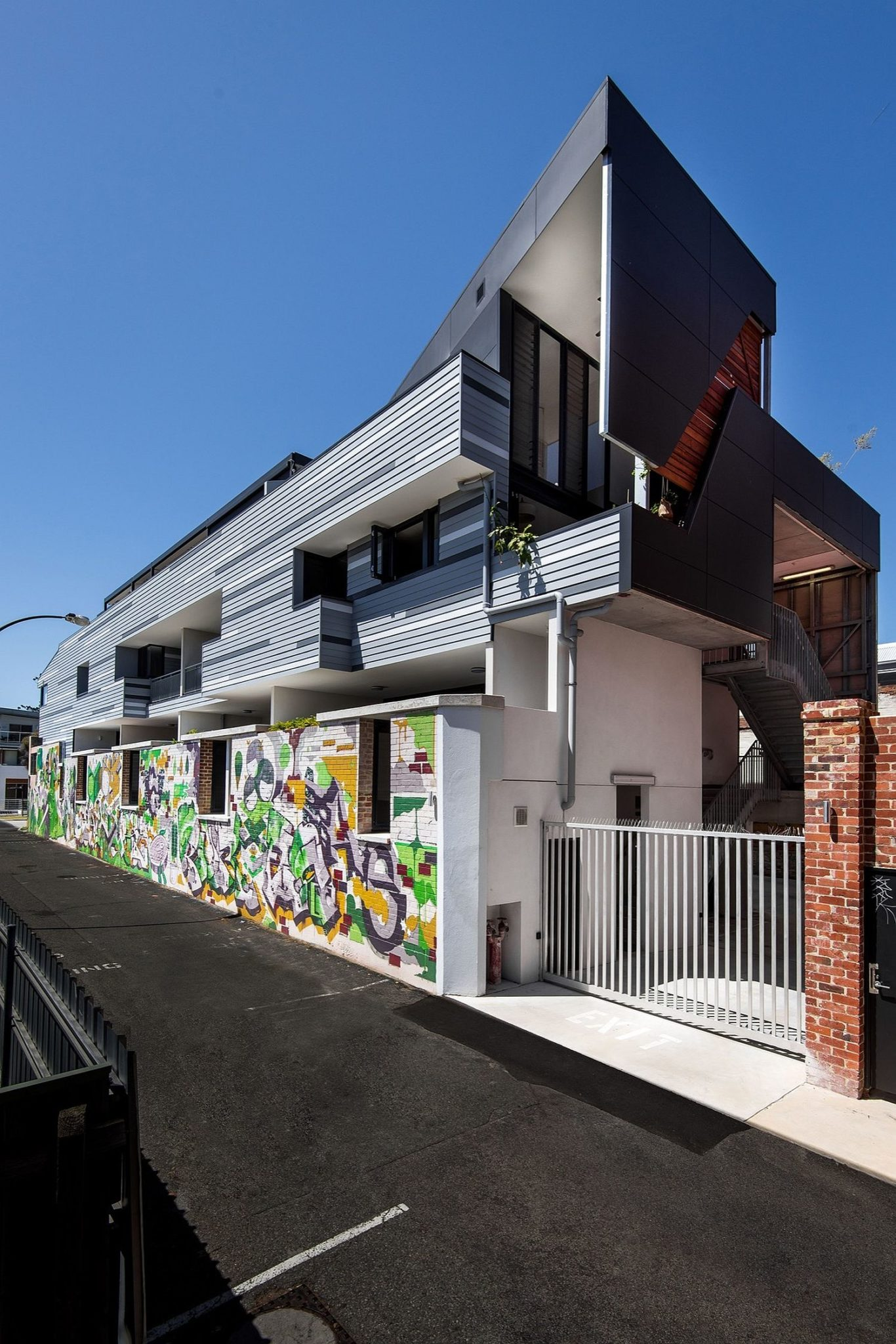 Street facade of the revamped heritage home decorated with graffiti