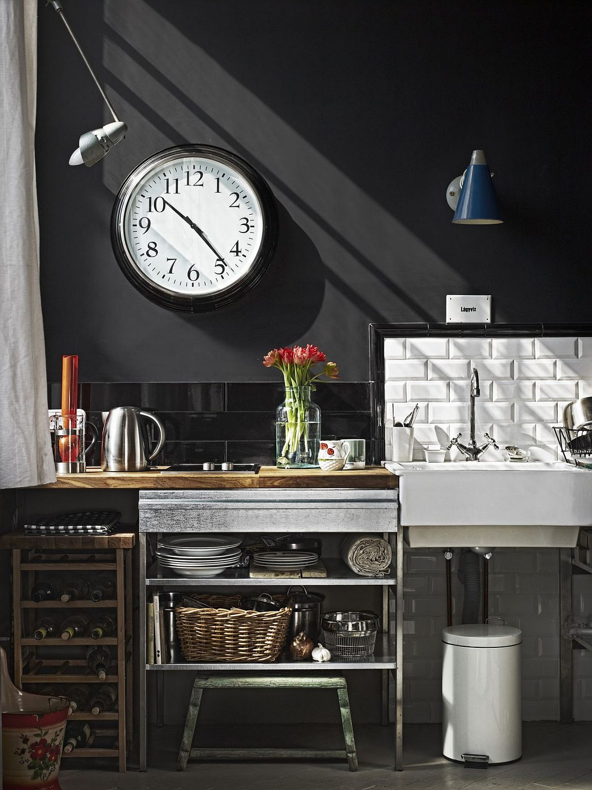 Tiny kitchenette for the small Budapest apartment with chalkboard wall