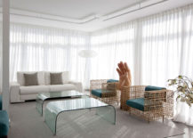 Two-identical-glass-tables-retain-the-breeziness-of-the-room-217x155