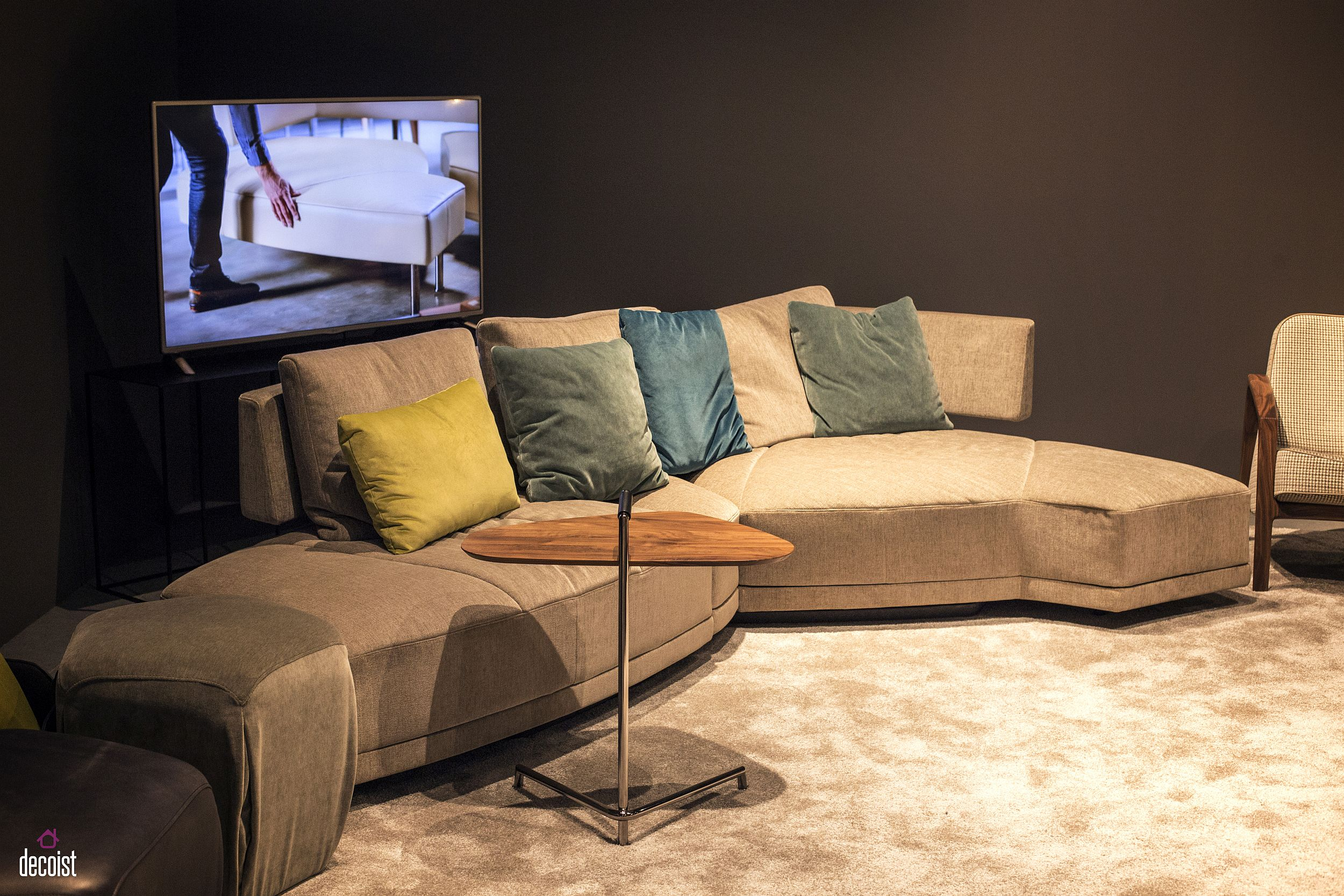 Ultra-minimal TV stand behind the couch vanishes into the backdrop!