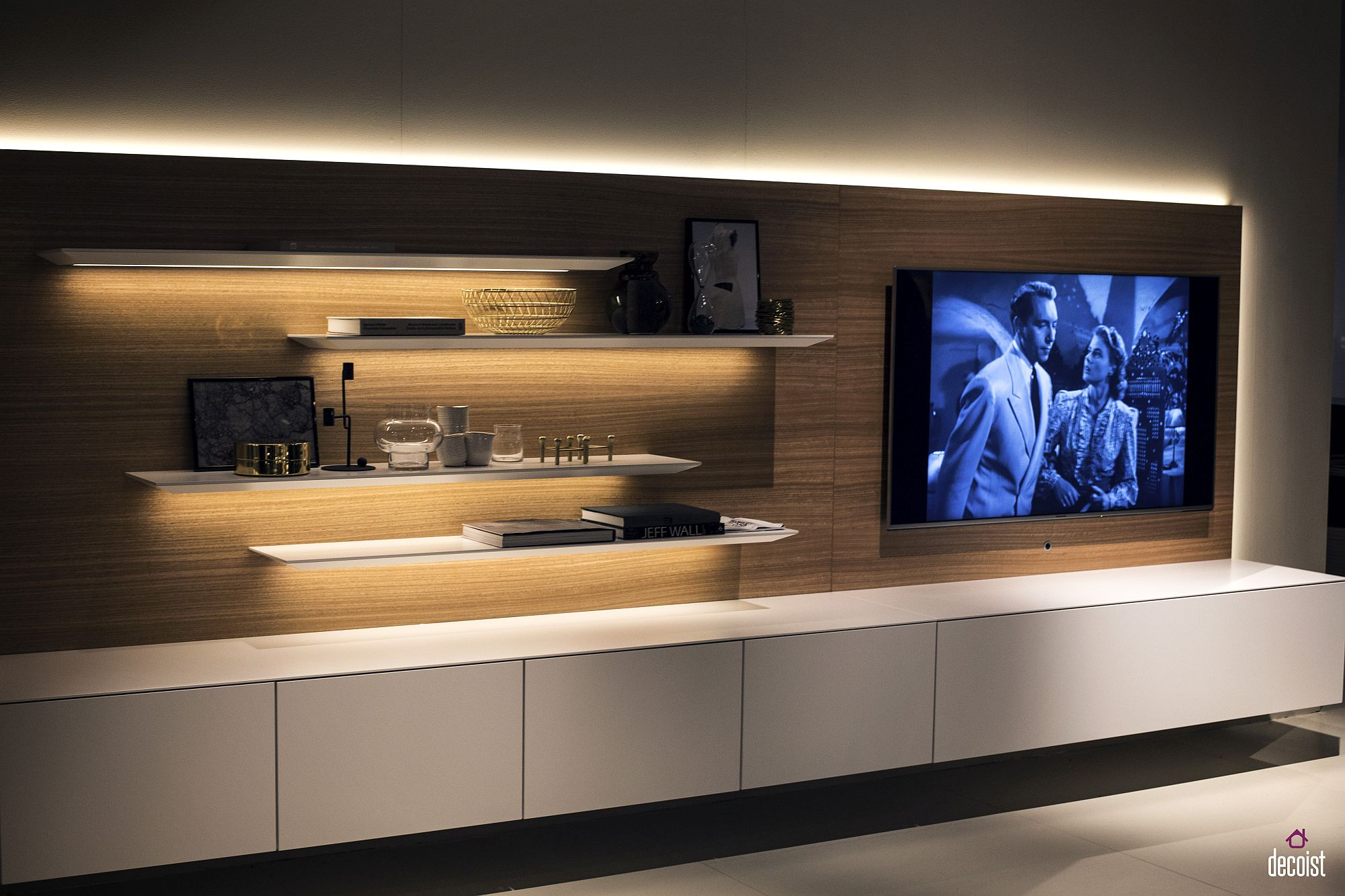 Under-shelf LED strip lighting adds to the aura of the TV wall unit