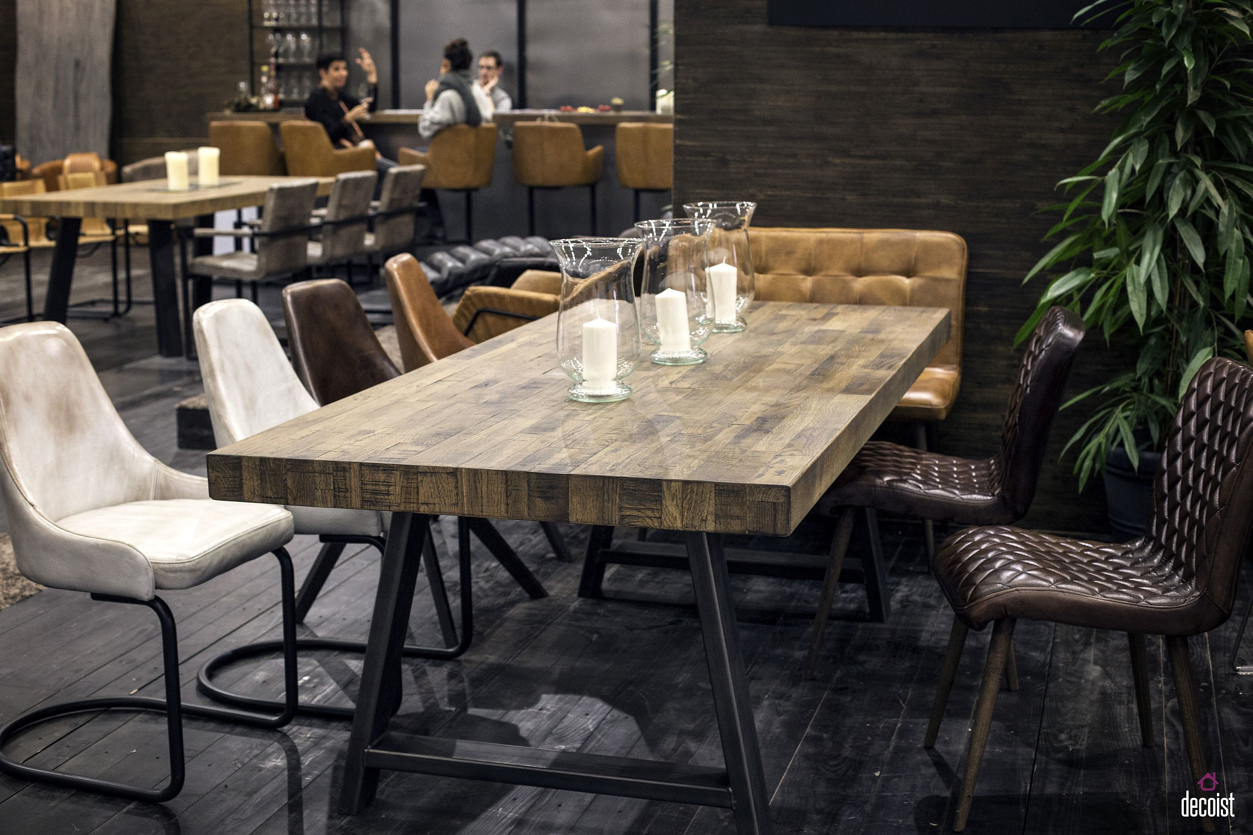 Unique surface of the wooden dining table steals the show here