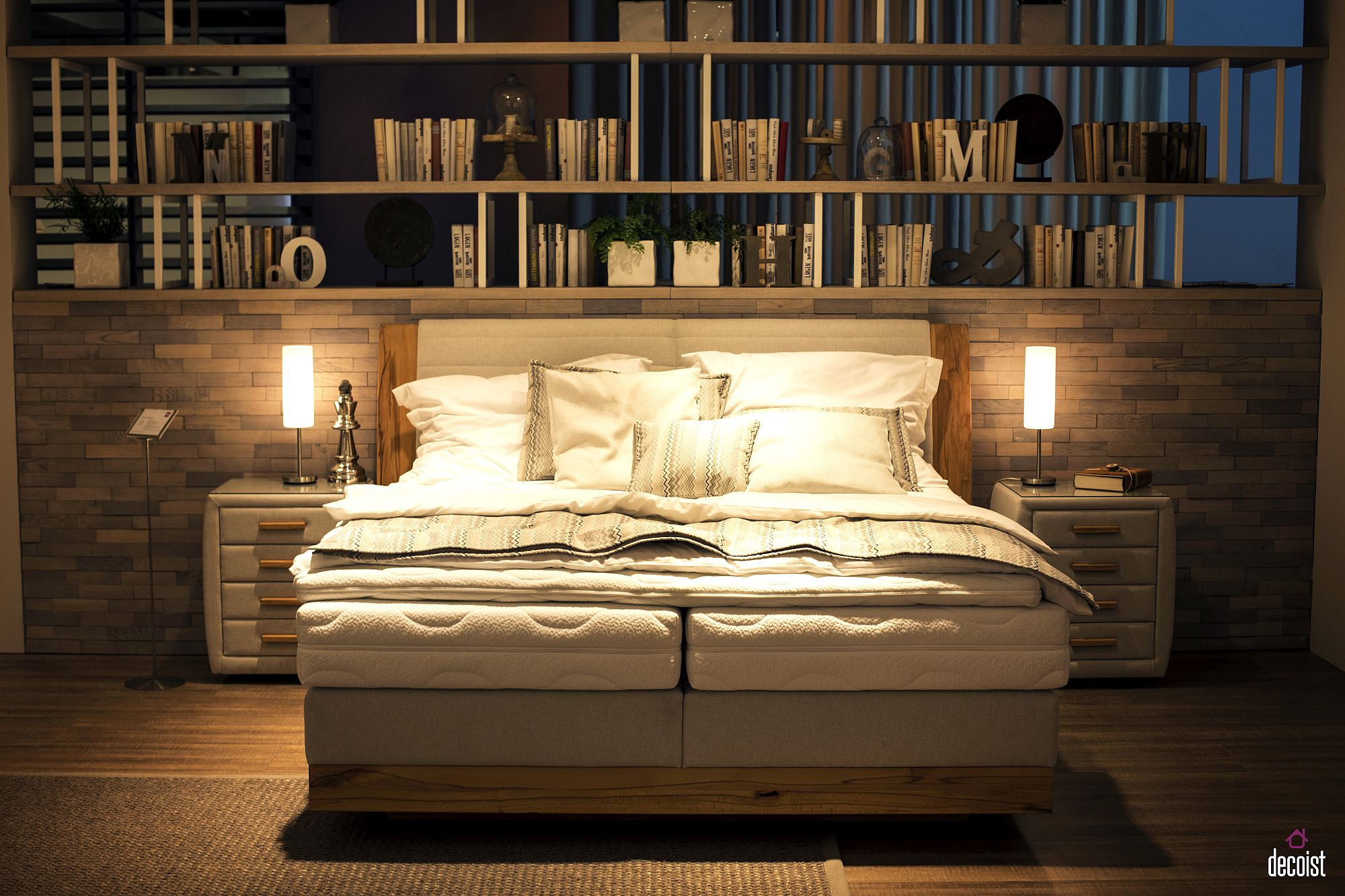 Wall of books above the bed for the avid reader 15 Bedside Tables and Nightstands with Understated Elegance