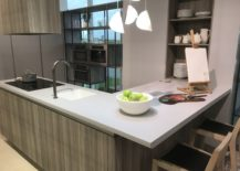 White-kitchen-island-top-with-wood-looking-ceramic-finishes-217x155