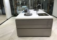 White-top-kitchen-island-with-glossy-drawers-by-Porcelanosa-217x155