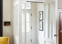 White-walls-and-subtle-decor-in-a-plain-entryway--217x155
