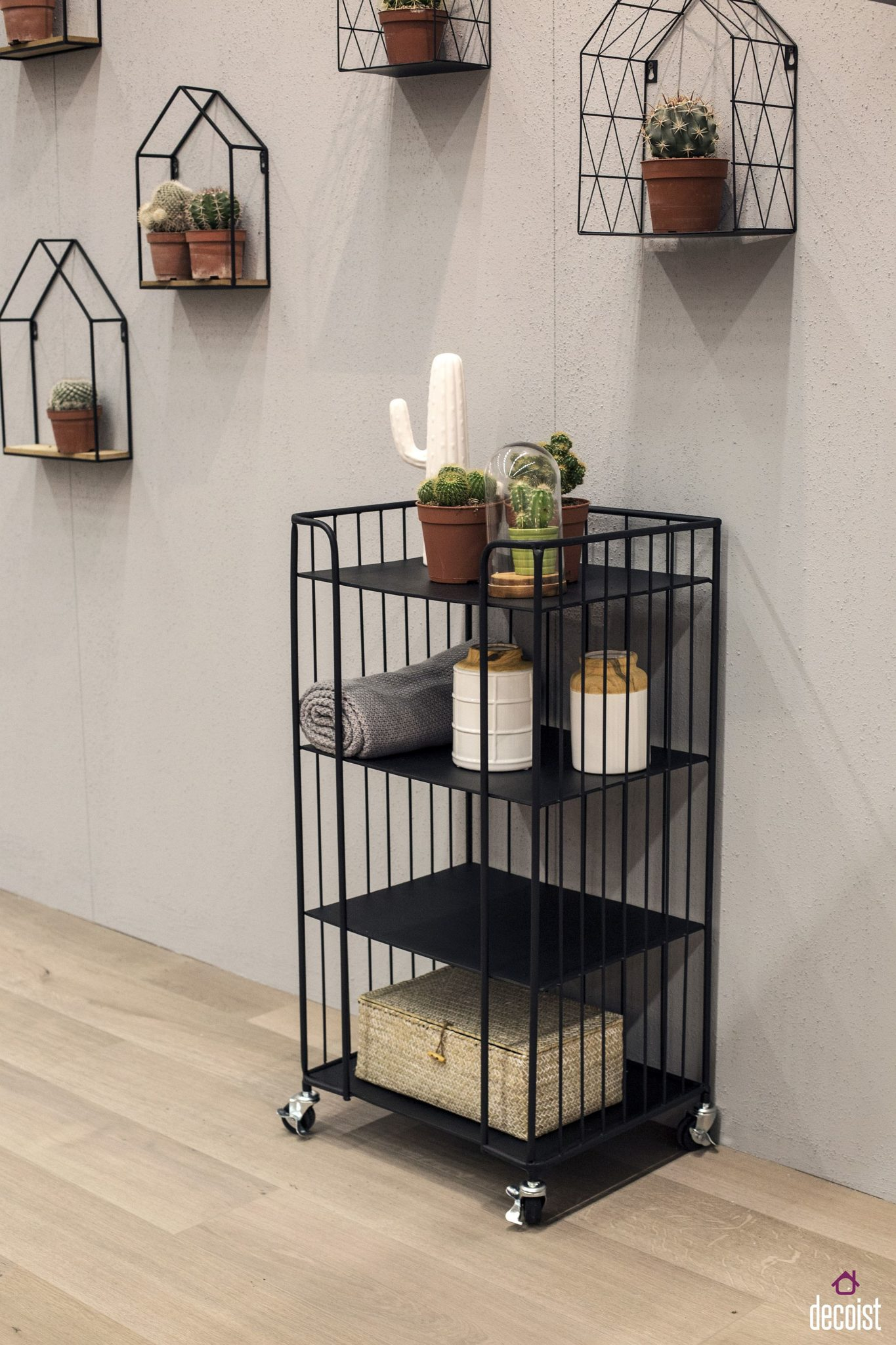 Wiry wall-mounted shelves are great decorative pieces all on their own!